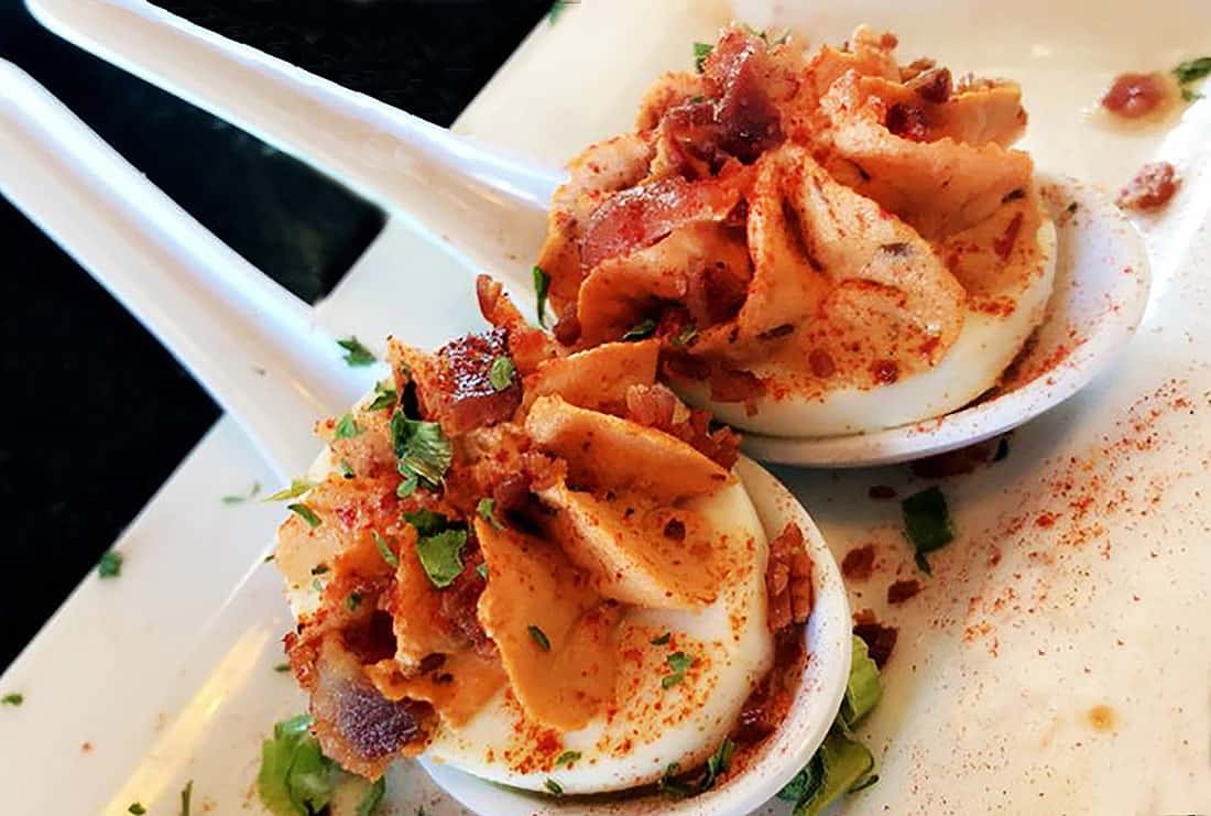 Beautiful chipotle deviled eggs, served in Japanese soup spoons, are a specialty at The Haunted Hamburger, in Jerome, Arizona