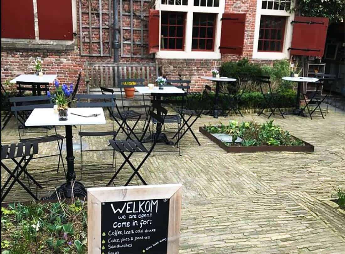 The cozy courtyard of De Koffieschenkerij, in Amsterdam's red-light district but a world away.