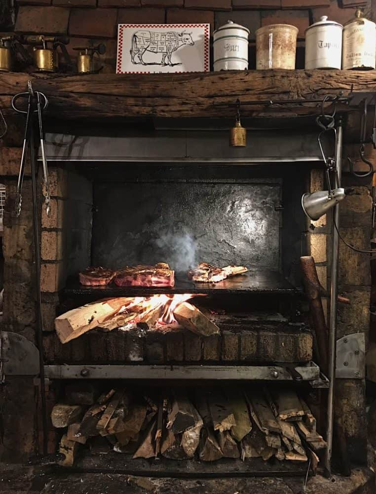 A review of Robert et Louise in the Marais, Paris, where steaks are cooked in the fireplace. #paris #restaurants #fromtheyums