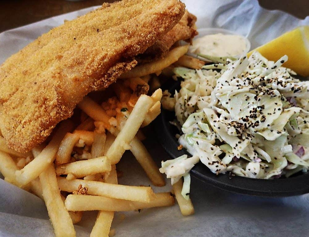 Cornmeal-crusted catfish and garlic fries with a side of coleslaw is a great take on fish and chips at The Prospector Cafe, Chloride, Arizona