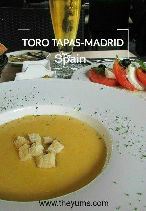 A bowl of creamy, butternut squash soup. Lunch at Toros Tapas Madrid, Spain