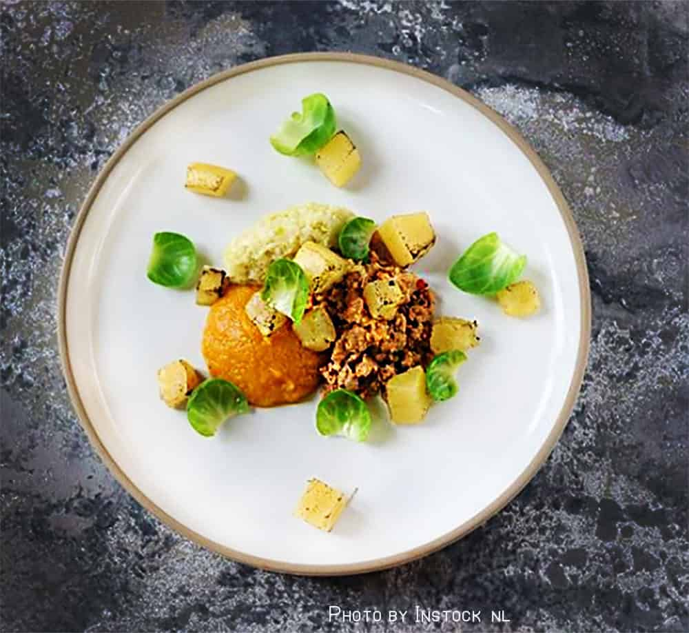 Instocks version of Nduja, made from sausage with a sauce of fermented chilil peppers, pumpkin puree and sprout pesto.
