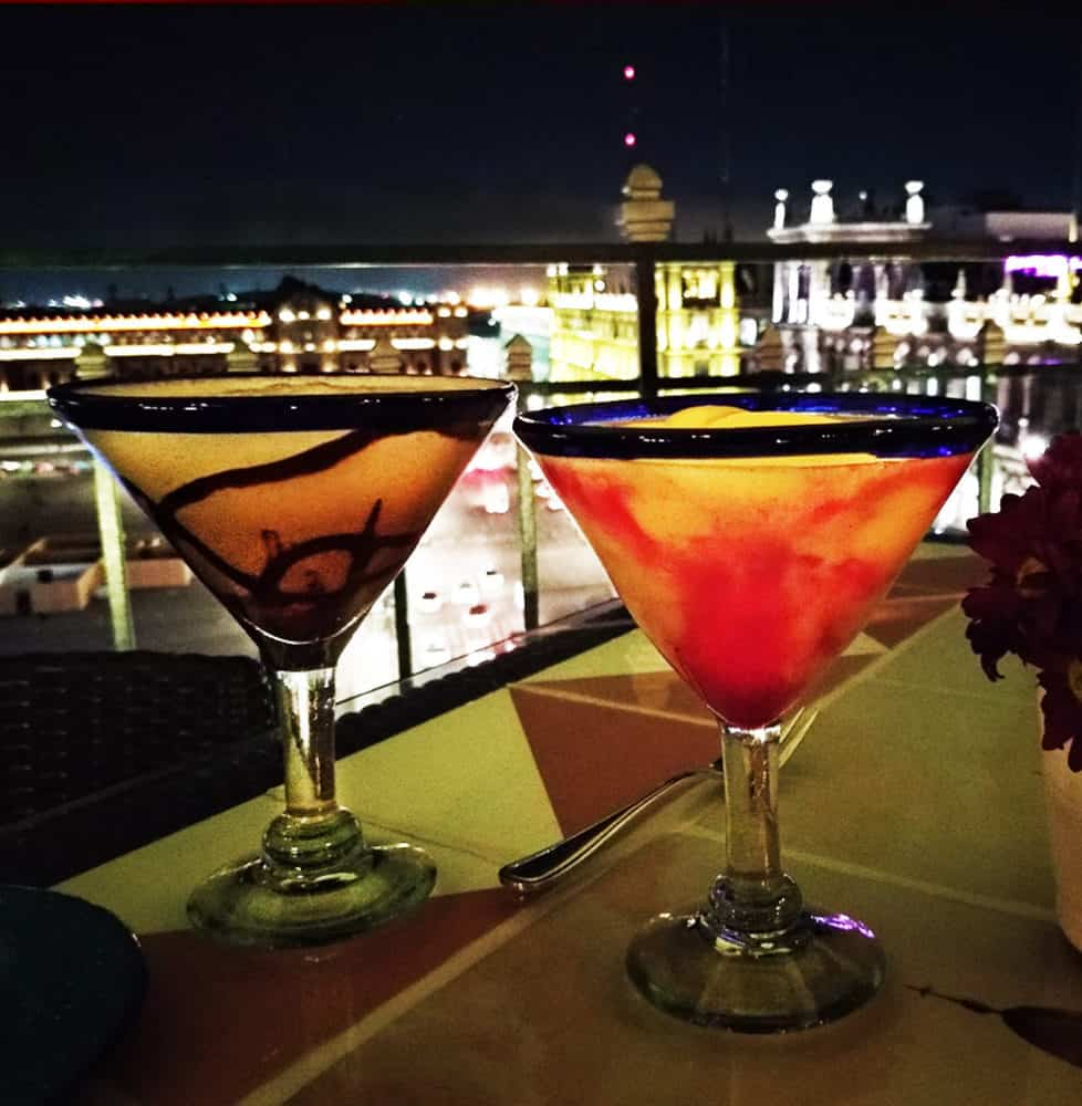 Flavored margaritas with a nighttime view of Mexico City's glorious zocalo, lined with 16th-century buildings at La Terraza rooftop restaurant at the Gran Hotel CDMX.