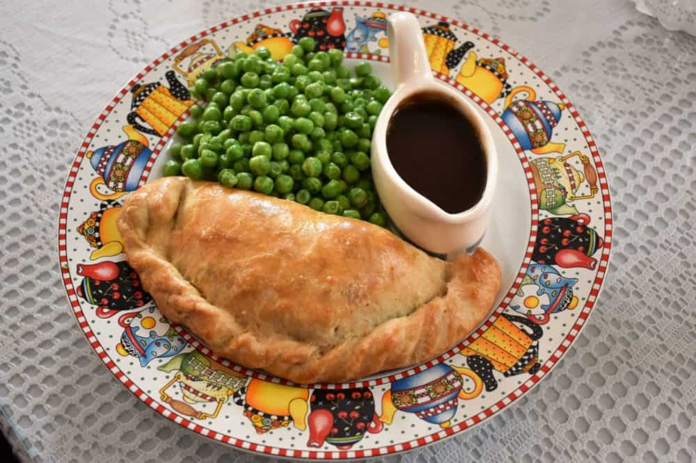 A Cornish pasty served with gravy and peas at Tina's Traditional Tea Room & Tavern