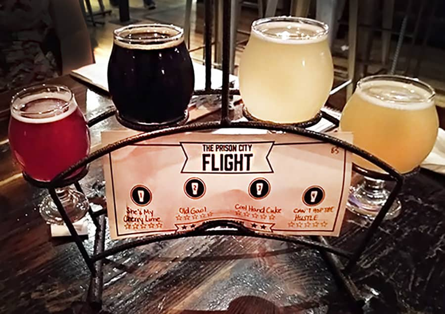 A flight of four beers at Prison City Brewery and Pub, in Auburn, New York. You can pick 5-ounce pours of any four beers you want to try.