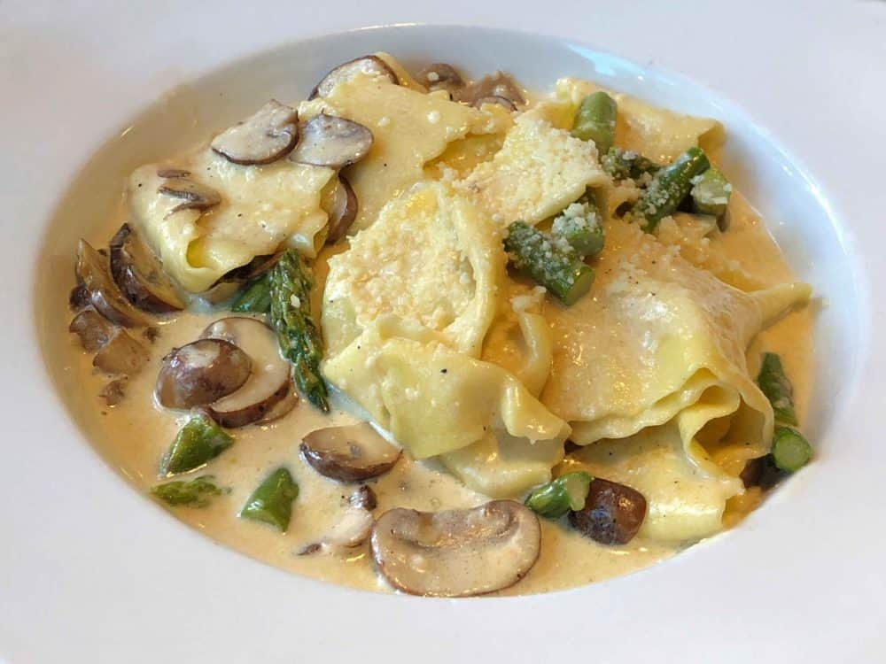 Italian traditional pasta with asparagus and mushrooms