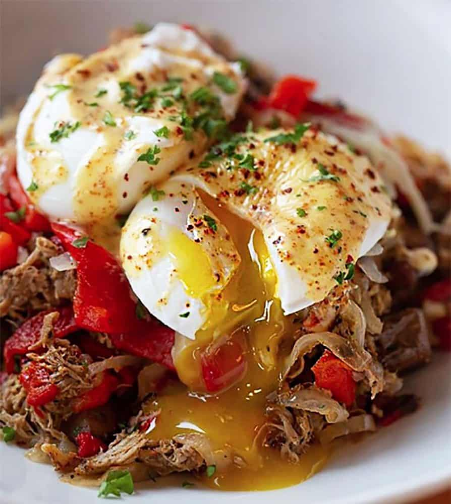 At Cafe Murrayhill, the pulled pork hash is studded with potatoes, roasted red peppers and onions and topped with a pair of perfectly poached eggs.